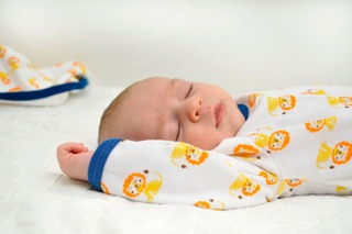 lion onsie baby sleeping